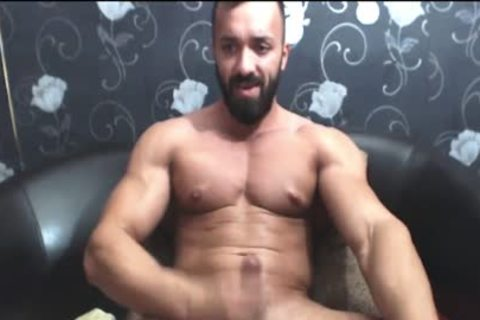 Bearded muscular fellow Strokes His big rod
