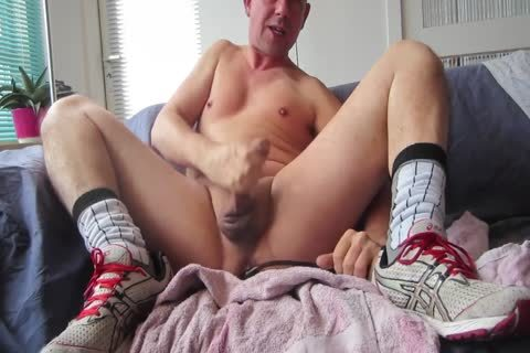 cook jerking In Front Of The Camera On The Sofa