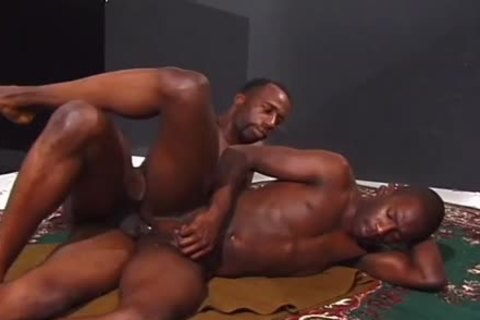 Two handsome darksome guys poke On The Floor