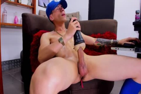 young brawny lad With Tattos Plays With Fleshjack And cum